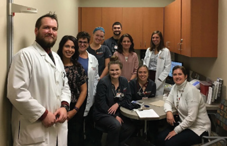 Providers and students from optometry, pharmacy, nursing, social work, and dental hygiene gather together at Ferris State University's Interprofessional Wellness Clinic to discuss ways they can integrate oral health into an existing program that serves diabetes patients.
